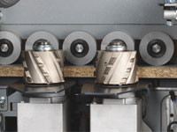Pre-milling Unit with two diamond tipped cutterheads rotating in opposite direction.